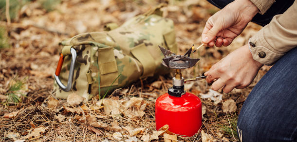 Man using a camping gas canister