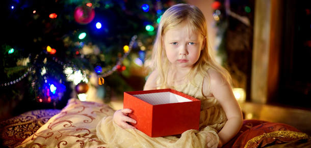 Young child unhappy with her Christmas gift