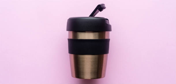 Reusable coffee cup with pink background